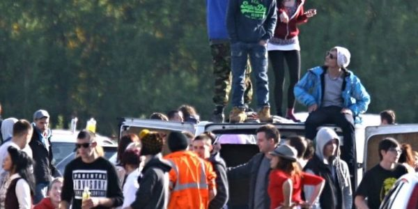 Youth Stand on a Car at an Illegal Rave Party in the UK