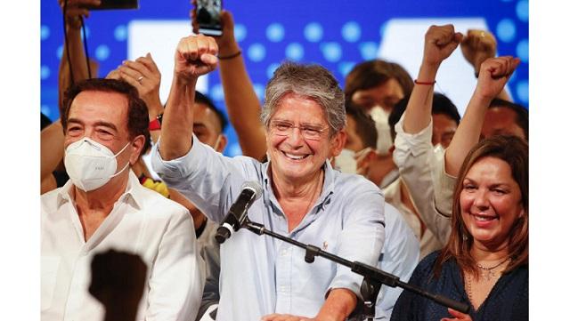 Ecuadorian businessman Guillermo Lasso wins Ecuador presidential runoff election 2021 after beating Andres Arauz